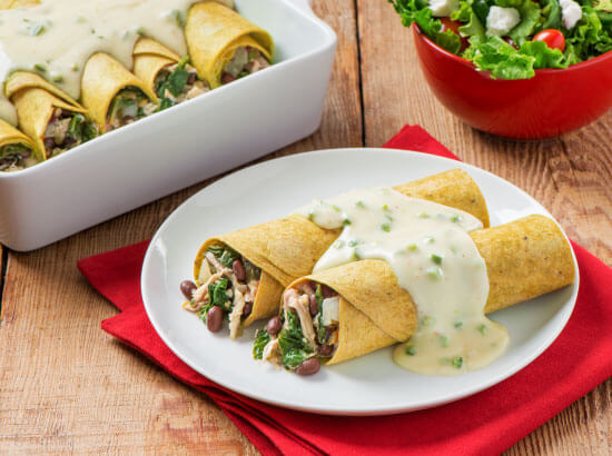 Chicken and Spinach Enchiladas with Jalapeno Cheese Sauce