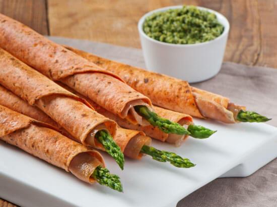 Prosciutto and Asparagus Cigars with Arugula-Walnut Pesto